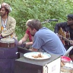 Isaac James (djembe on Yula) with Borrina Mapaka (writer of Yula)  in Talkeetna, Alaska 2004.