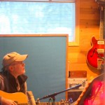 Alex Clarke on acoustic slide - Fireweed Ladies.  10th Planet Studio engineer Pat is on the right getting him set up.